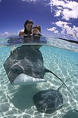 Tourists and Pink Whipray in Tahaa in French Polynesia