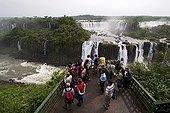 Tourists on lookout Iguazu Falls Parana Brazil