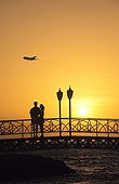 Couple on a bridge at sunset Aruba Dutch Caribbean