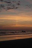 Sun pillar at sunset over the seaBritain France
