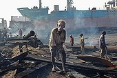 Construction workers of ship breaking in Bangladesh ; On the shores of Bay of Bengal in the south-eastern Bangladesh, near Chittagong, are the demolition of vessels. The industry is controversial once considered delicate and specialized, concentrated in developed countries, it was moved in the 1980s on the coast of Pakistan, India and Bangladesh, to minimize costs. The positive economic and environmental impact of the recycling industry is controversial because offset by violations of human rights and labor and environmental pollution. This industry is the deadliest in the world.<br>Anisur, 42, works in the demolition for nearly 20 years. Very few of them so long, the majority of workers under 30 years and the only work a few years. He now has skin problems and breathing it binds directly to its activity, but no medical examination is able to confirm it.