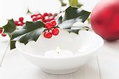 Holly branches with berries Candle and Christmas Ball