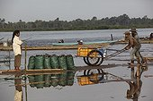 Transport of charcoal on the banks of the Mekong River Laos