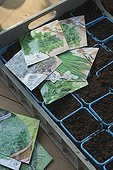 Seed packets of herbs and bucketsof vegetal mould France