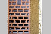 Wall insulation with natural materials ; From inside to outside: lime wire - wood fiber - honeycomb brick