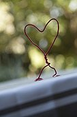 Wire made heart on a garden terrace
