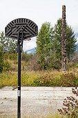 Gitxsan Totem and basketball court in British Columbia