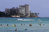 Swimming on the beach at Waikiki Beach in Honolulu Hawaii