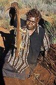 Aboriginal lady hunting sand monitors in Australia ; Warlpiri Aborginal community of Alice Spring