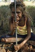 Aborginal girl hunting sand monitor in Australia ; Warlpiri Aborginal community of Alice Spring
