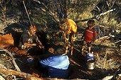 Honey ants gathering by Aboriginal ladies in Australia ; Warlpiri Aborginal community of Alice Spring