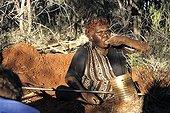 Aboriginal lady eating an honey ant in Australia ; Warlpiri Aborginal community of Alice Spring