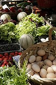 Fruits and eggs on a stall in a market