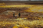Soldiers escorting a tourist at Crater Dallol Ethiopia  ; The border with Eritrea forced a heavily armed military escort.