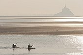 Kayaks in front of the Mont Saint Michel at sunsetFrance