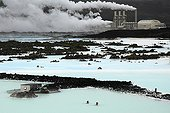 Bath in the warm waters of Blue Lagoon Iceland ; The discharge of hot water from power plant are used for spa, a place is very popular in Iceland near Reykjavik.