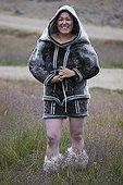 Woman in traditional dress Ammassalik Greenland