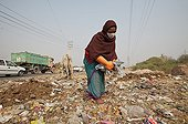 Collection of plastic bags in the streets of Delhi India ; Plastic bags are recycled into bags and fashion accessories ethics.