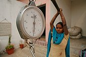 Weighing of plastic bags collected in the streets India ; Recycling bags and fashion accessories ethics