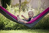 Child in a hammock in the spring France