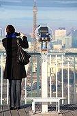 Photographer on the terrace of the Tour Montparnasse Paris ;