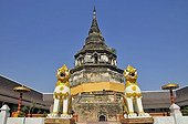 Gilt statues in front of an old stupa, Wat Yaang Kuong Temple, Chiang Mai, Thailand, Southeast Asia