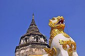 Gilt statue in front of an old stupa, Wat Yaang Kuong Temple, Chiang Mai, Thailand, Southeast Asia