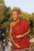 Young monk laughing Monastery Nyaungshwe Burma