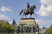 Equestrian statue of King Frederick William III of Prussia created by Gustav Blaeser, statues on the base of the monument, Heumarkt square, Cologne, North Rhine-Westphalia, Germany, Europe