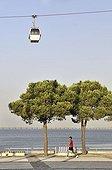 Joggers and gondola in the Parque das Nações park, site of the Expo 98, Lisbon, Portugal, Europe