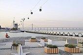 Painted Benches, gondolas and meditating man, Parque das Nações park, site of the Expo 98, Lisbon, Portugal, Europe
