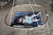 Baby taking a nap in a hammock bamboo in Laos