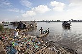 Boat loaded with supplies and trash Tonle sap Cambodia
