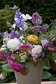 Flowers bouquet on a garden terrace