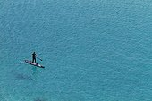 Man practicing Stand up paddle surfing in Cape Taillat