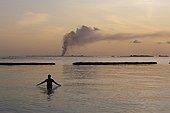 Sea bath at sunset Indian Ocean Maldives