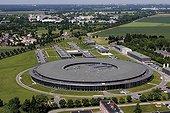 Anneau de 113 mètres de diamètre du Synchrotron SOLEIL ; © Ch. Kermarrec/SOLEIL. Le synchrotron SOLEIL (Source Optimisée de Lumière d'Énergie Intermédiaire du LURE) est un synchrotron de troisième génération optimisé dans la gamme des rayons X moyens