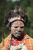 Kikuyu warrior wearing headress made of Guineafowl feathers
