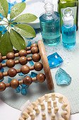 Wooden massagers and essential oil bottles close-up