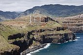 Wind turbines on the eastern tip of the island of Madeira ; High and steep cliffs overlooking the sea more than 180 meters high