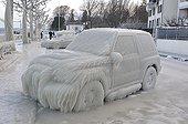 Vehicle on the icy shores of Lake Geneva Versoix Switzerland