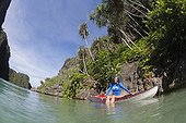 Woman explores and snorkels karst islands by kayak Indonesia