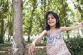 Girl in the garden birds Isfahan Iran