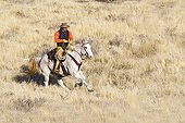 Cowboy in the prairie The Hideout Guest Ranch Wyoming USA ; Tom Bercher
