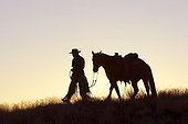 Cowboy at sunset The Hideout Guest Ranch Wyoming USA