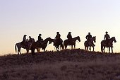 Cowboys at sunset The Hideout Guest Ranch Wyoming USA