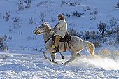 Cowboy in the snow The Hideout Guest Ranch Wyoming USA ; Tom Bercher