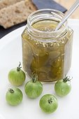 Tomato jam jar green cherries and green cherry tomato