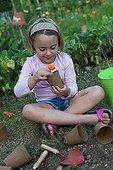 Little girl playing in a kitchen garden