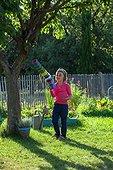 Little girl playing in a garden